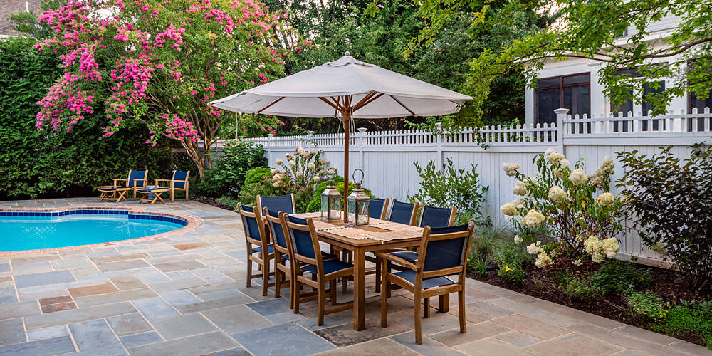 Patio furniture with table and umbrella