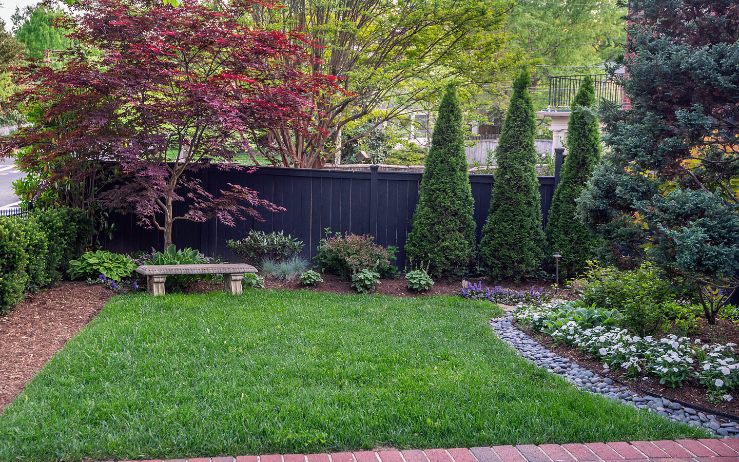 Front yard bench and plantings