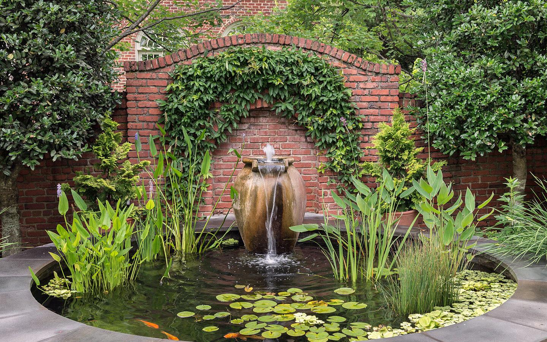 Fountain pot in koi pond