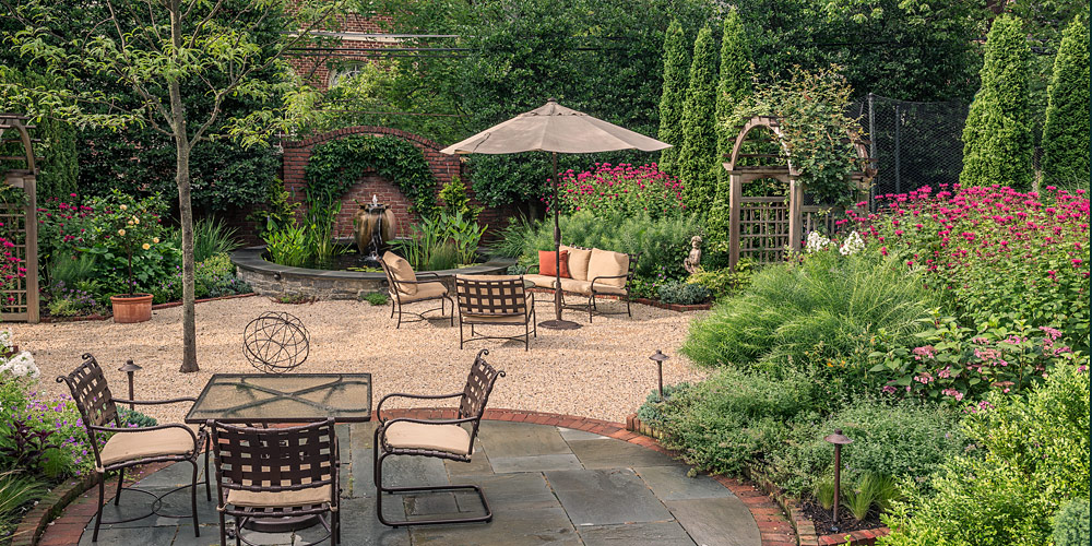 Lush backyard garden, fountain and seating