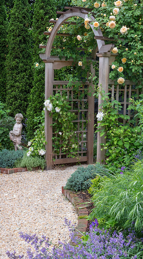 Garden statuary and Rose Arbor