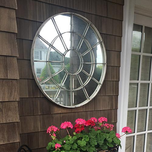 Vintage circle mirror on exterior wall