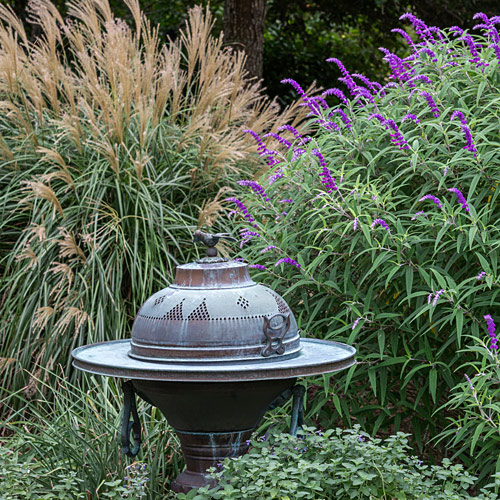 Domed structure with bird finial in the garden
