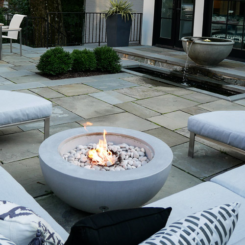 Fire pit and water fountain on patio