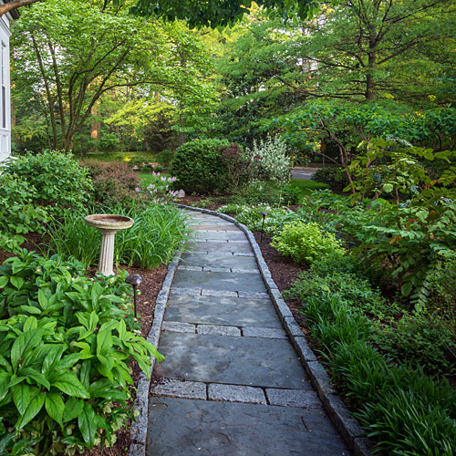 Flagstone and Brussell block pathway through the garden