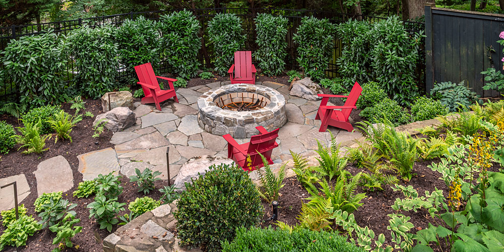 Flagstone patio with built in fire pit