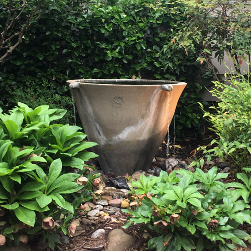 Large fountain pot in garden