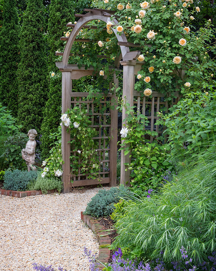 Garden Arbor with roses and statuary