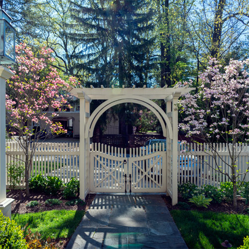 Gate surrounded by pink dogwoods