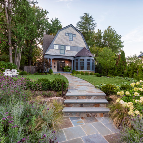Plantings and flagstone path to home entrance