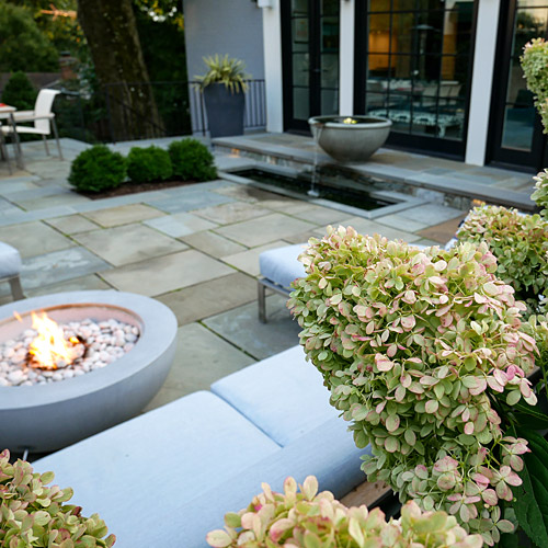 Fire pit, hydrangea and fountain