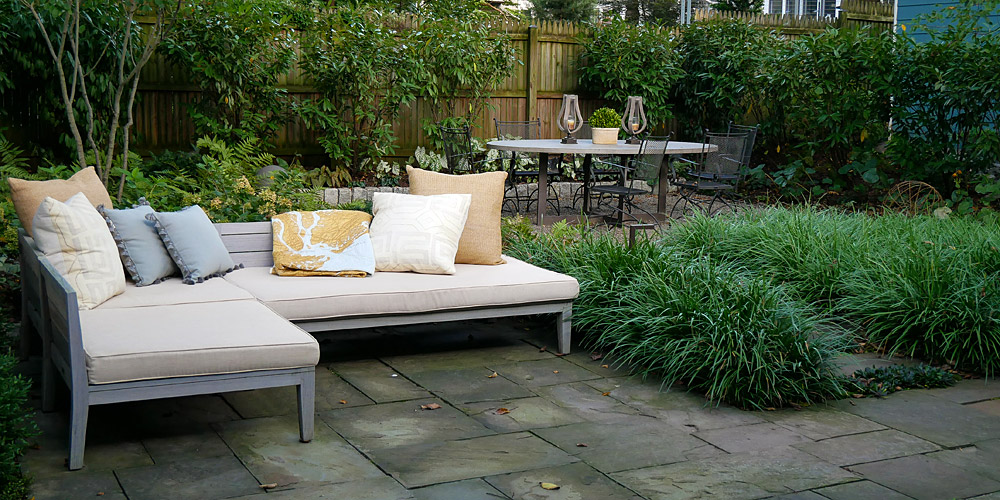 Outdoor garden room with sitting and dining areas