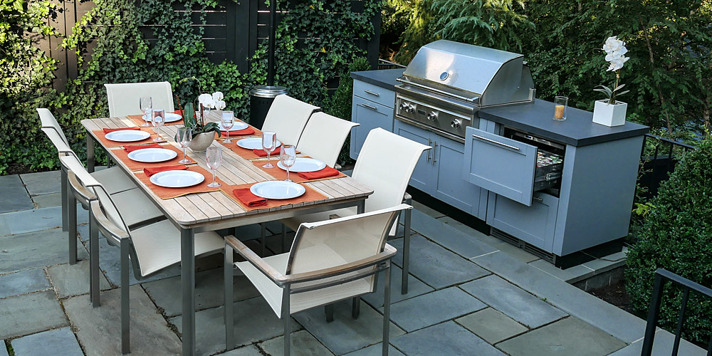 Outdoor patio, table, grill and refrigerator