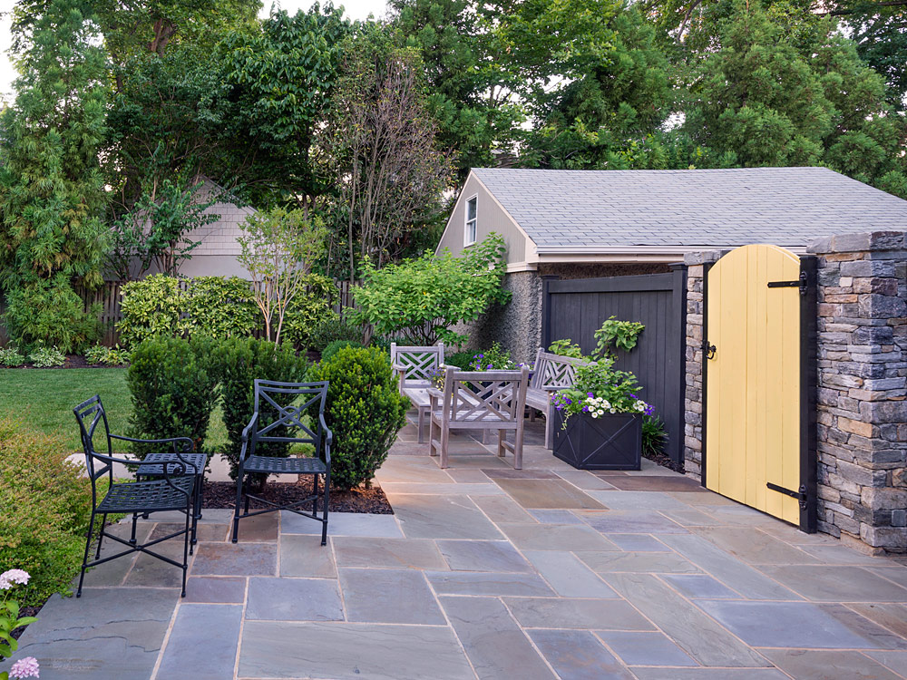 After shot of backyard with patio and furnishings